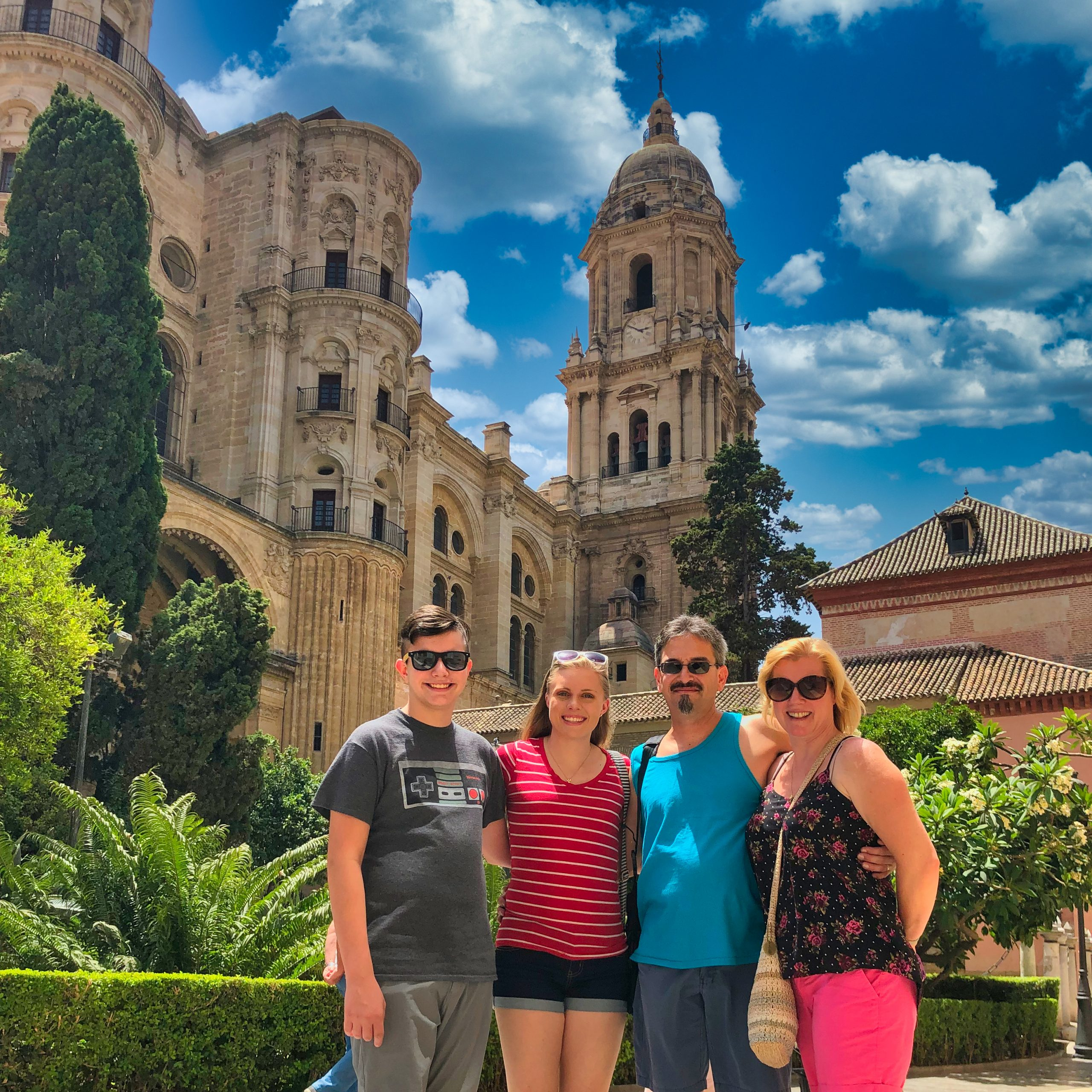 Travelers next to the cathedral of Malaga