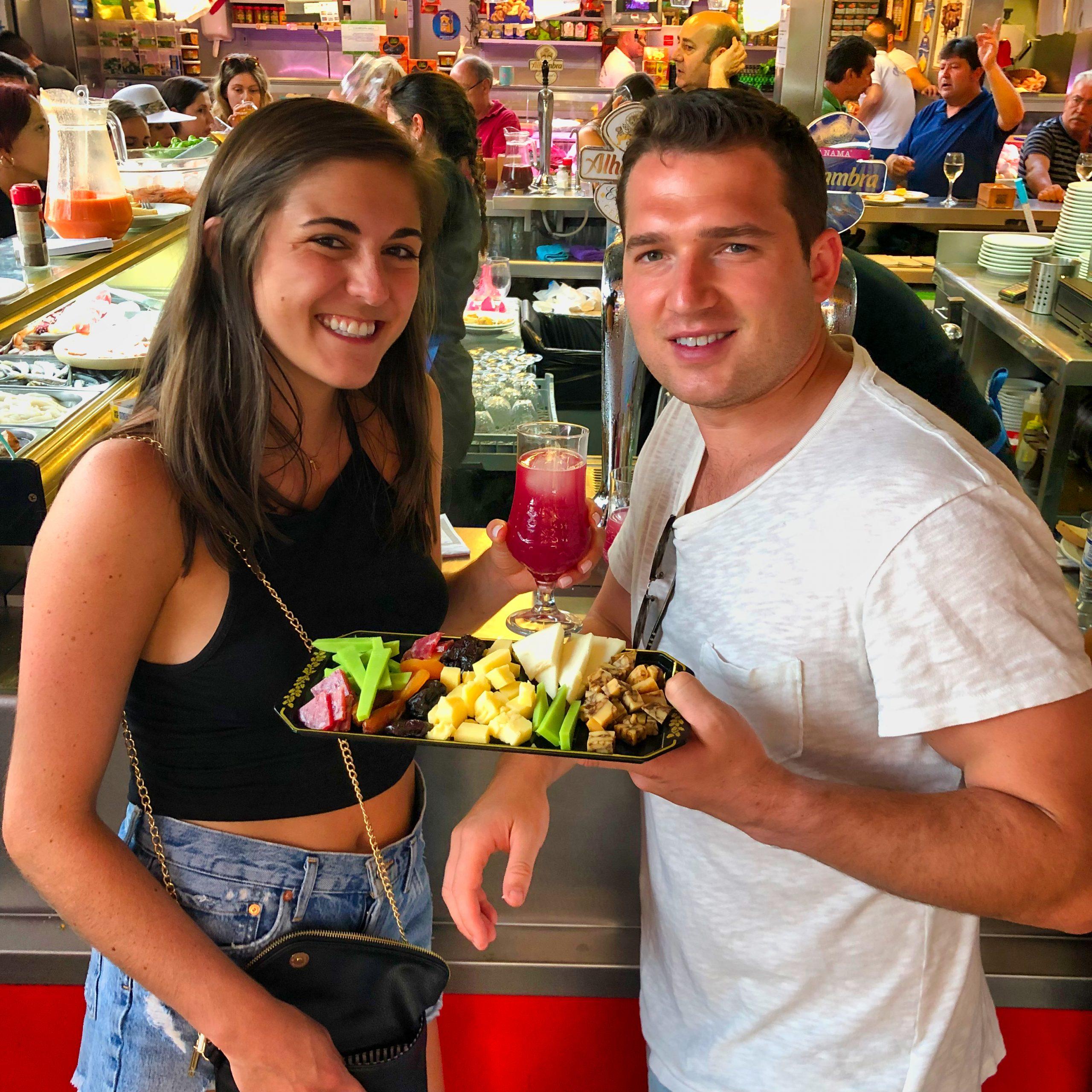 Happy travelers eating tapas